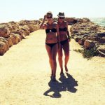 Kylie Hirth and a friend walk along the beach about 10 minutes from Murdoch University in Perth, Australia.