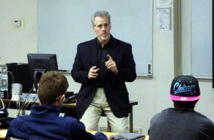 """Bob Jones, WWU coordinator of fitness and recreation, speaks to students during """"Leadership After the Woods."""""""