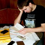 A young man struggles to balance his expenses and pay his bills. (Photo courtesy of PhotoBucket)