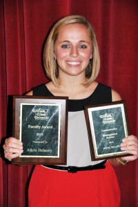 Alicia Delaney holds just some of the awards she received recently at William Woods University.