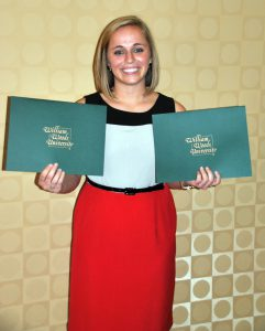 Alicia Delaney holds the certificates she received for being selected as an Outstanding Senior and elected to Who's Who.