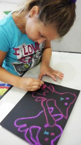 Ellie Sain draws cats during last summer's Kemper Kids Summer Creativity Camp.