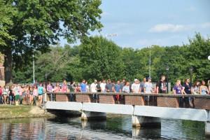 Incoming students cross Senior Lake Bridge during the 2013 Ivy Ceremony.