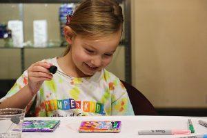 Brooklyn Keller, 5, works on an art project.