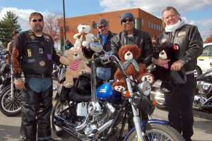Riding in on their bikes in 2013, members of Bikers Against Child Abuse, Inc. (B.A.C.A.) arrive at William Woods University to speak in conjunction with Child Abuse Awareness Month.