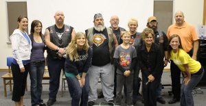 Bikers pose with representatives of the Social Work department during a previous visit.