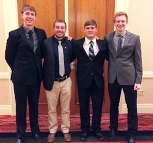 Preston Wolfe, Dakota Smith, Bridger Pretz and Bennet Zink celebrate their fraternity's success at its biennial convention, during which Wolfe and Smith both received major awards.