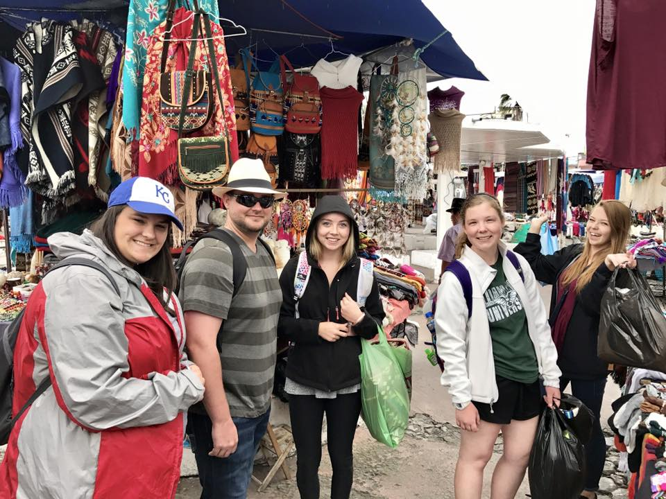 Students visit an open market