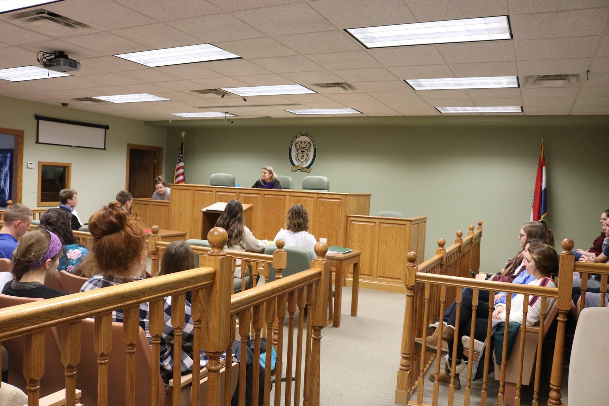 Stephen George in mock courtroom