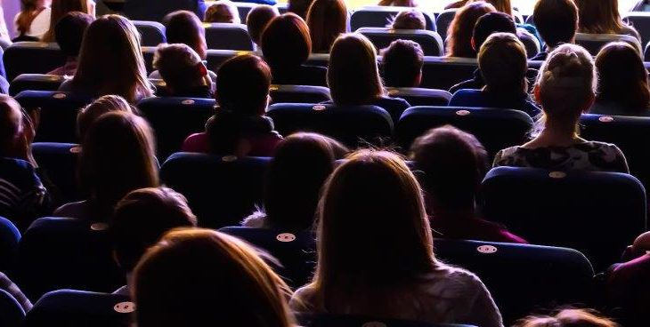 People in a theatre