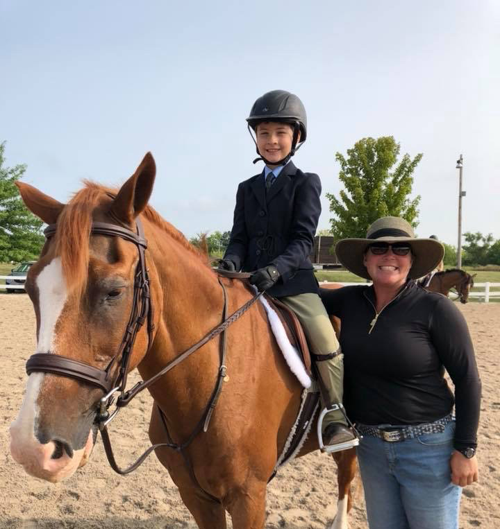 Picture of Patti and a student on her horse