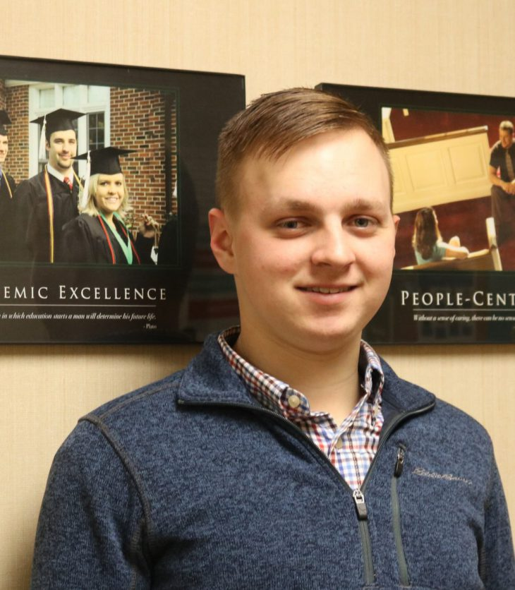 Photo of Ethan Schroyer in the Burton Business Building