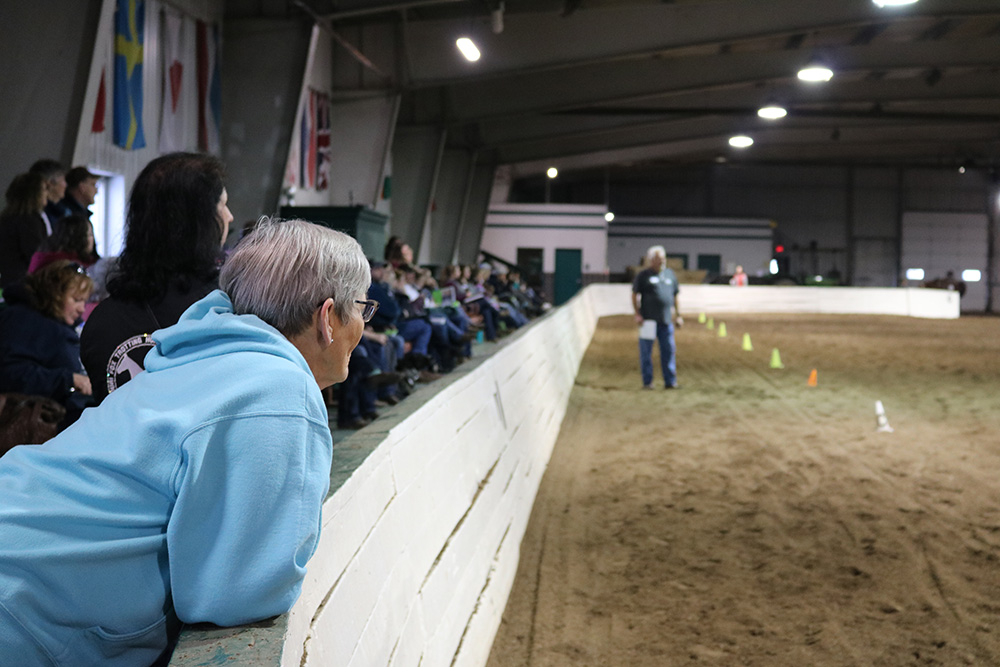 Photo of a crowd listening to a judge at the clinic
